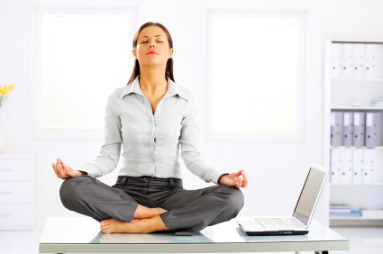 Businesswoman Meditating On Desk